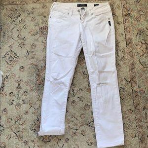 Distressed white boyfriend jeans